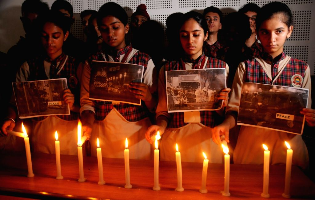 Students an Amritsar school participate in a candlelight vigil held for the victims of France terror attacks on July 15, 2016.