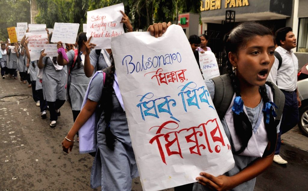 Students and activist participate in a rally to protest against Brazilian President Jair Bolsonaro over Amazon rainforest fires in Kolkata on Aug 26, 2019.