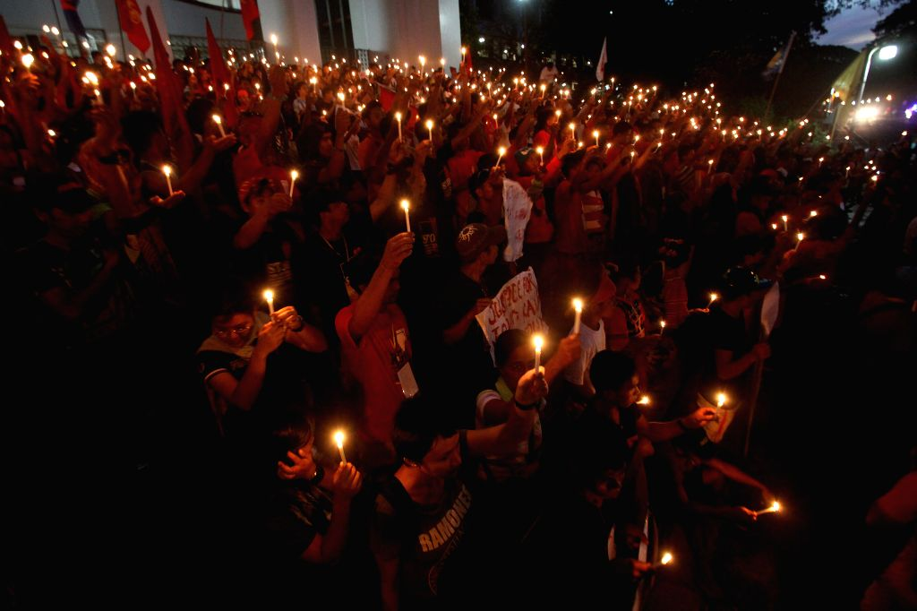 Students and Lumad people, a group of indigenous people from Southern Philippines, light a thousand candles during a protest rally in Quezon City, the ...