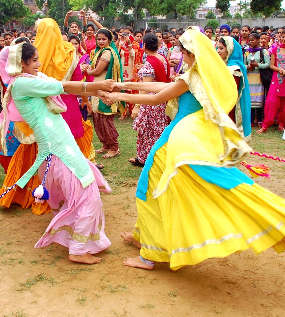 Students and Teachers celebrate the Teej festival in Amritsar on July 27, 2016.