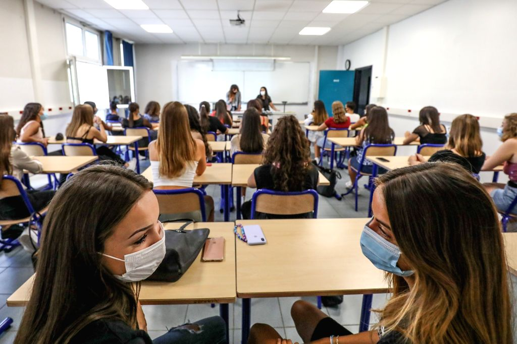 Students and teachers wearing protective masks attend a class at a high school on the first day of the new school year in Nice, southern France, Sept. 1, 2020. The new ...
