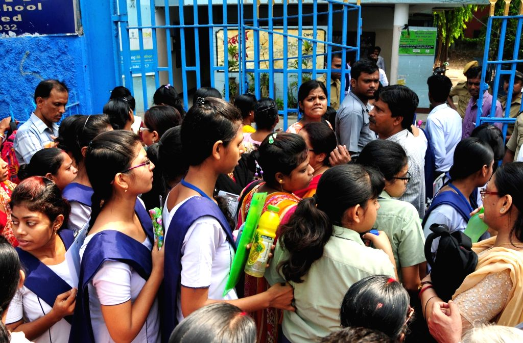 Students appearing for their class 12th Board examinations, outside their exam center in Kolkata on March 27, 2018.