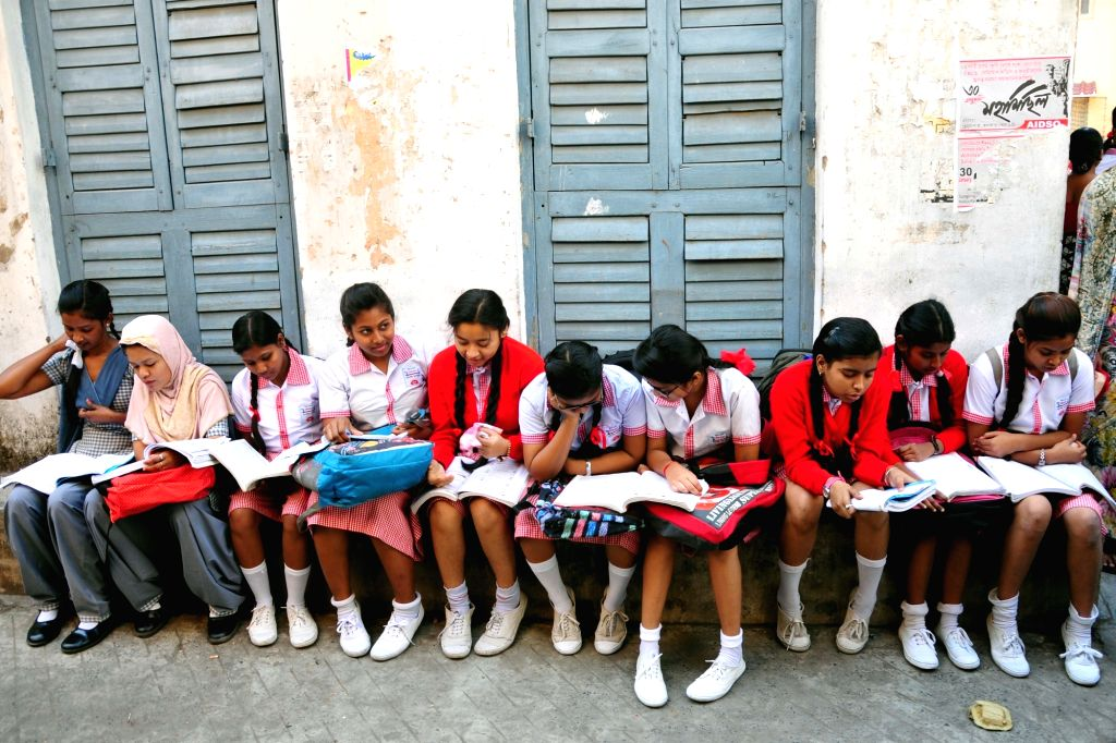Students appearing in Madhyamik exams Class 10 board examinationsconducted by West Bengal Board of Secondary Education busy with last minute revisions outside an exam centre in ...