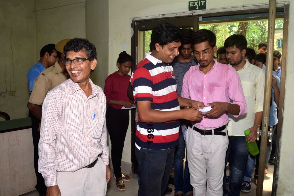Students arrive at an examination centre to appear the Joint Entrance Examination (JEE) 2019 in Kolkata, on May 26, 2019.