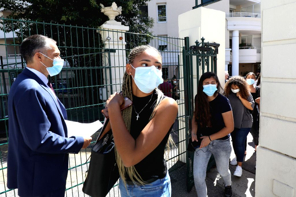 Students arrive at the campus of a high school on the first day of the new school year in Nice, southern France, Sept. 1, 2020. The new school year kicked off on ...