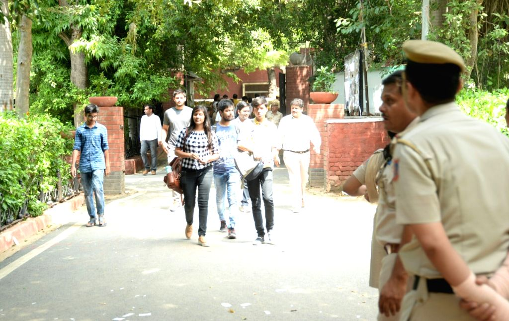Students arrive to cast their vote during Delhi University elections in New Delhi on Sept 12, 2017.