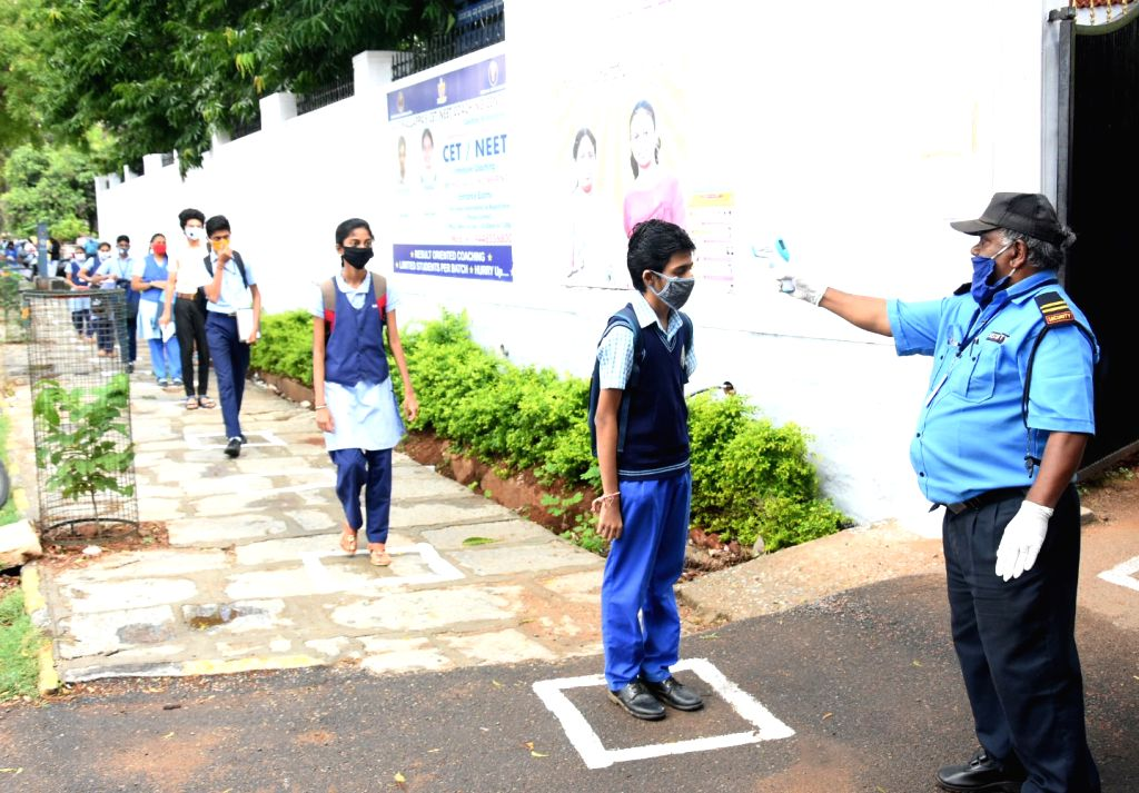 Students arriving to appear for their remaining Secondary School Leaving Certificate (SSLC) examinations maintain social distance, in Bengaluru on June 25, 2020.