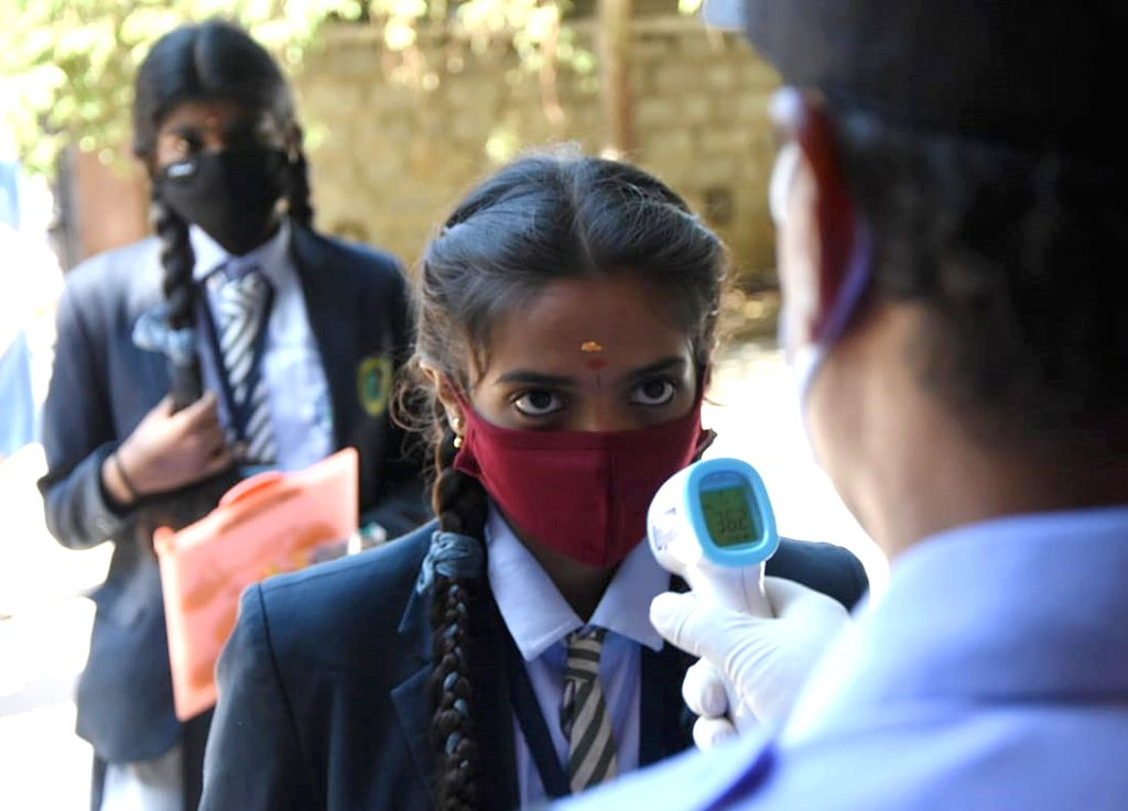 Students arriving to appear for their remaining Secondary School Leaving Certificate (SSLC) examinations undergo thermal screening for COVID-19, in Bengaluru on June 25, 2020.