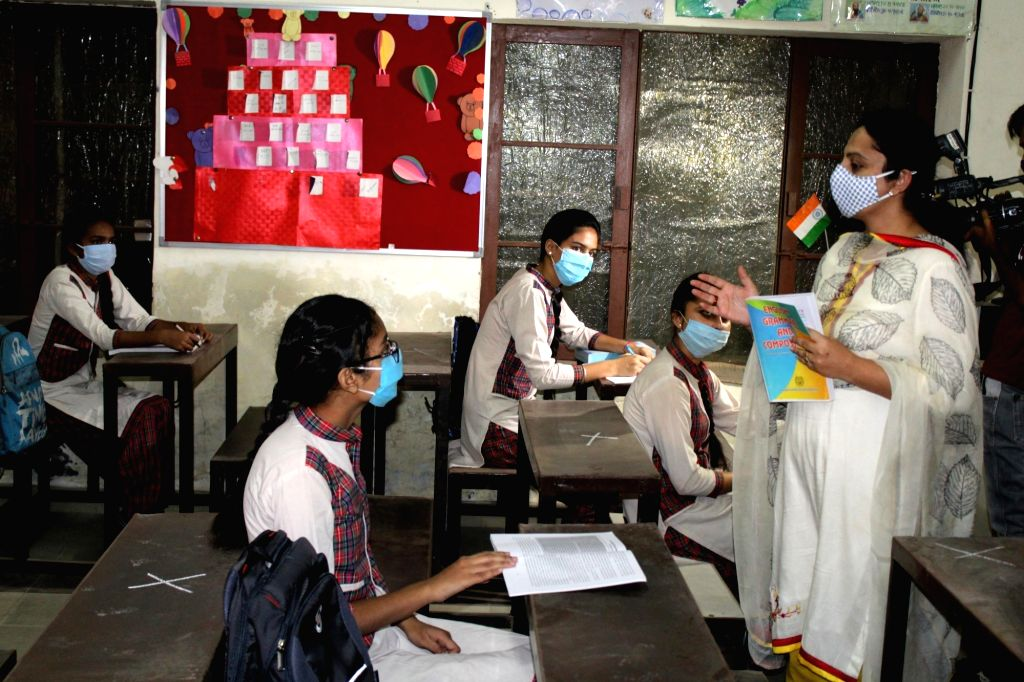 Students attend their classes at a government school after educational institutions reopened with strict COVID-19 norms in place, after nearly six months of their closure due to the ...