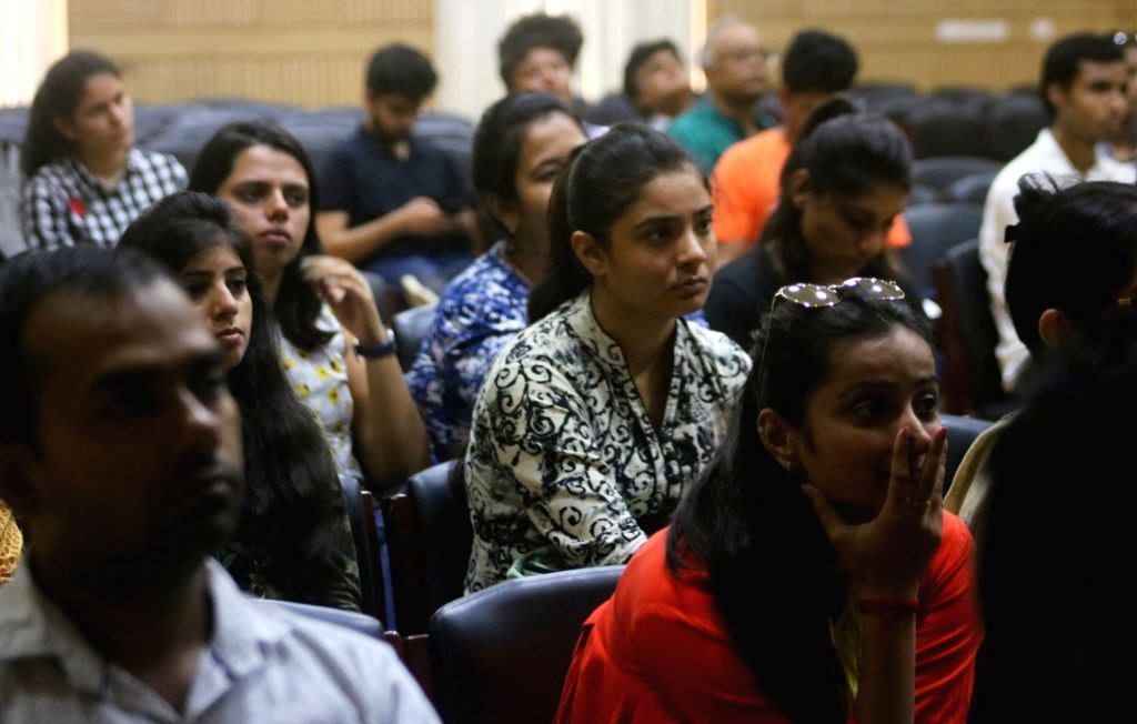 Students attending an open house discussion on admission process at Delhi University in New Delhi on June 1, 2018.