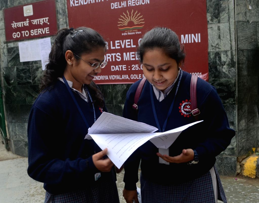 Students busy with last minute revisions outside an examination centre on the first day of CBSE Class 12 exams in New Delhi on March 2, 2019.
