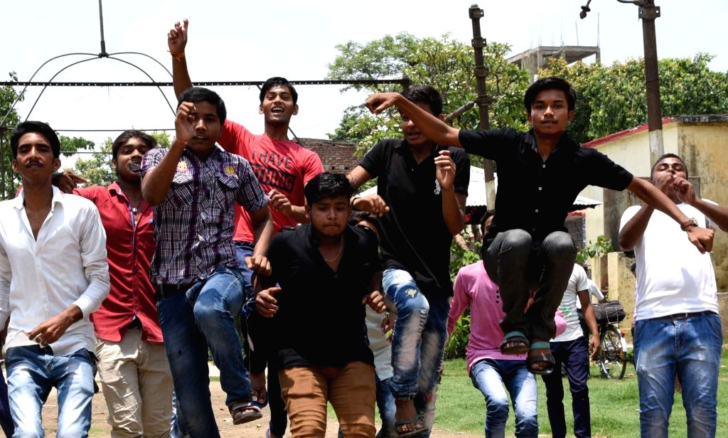 Students celebrate after Bihar School Examination Board (BSEB) exam results were declared in Patna on June 22, 2017.