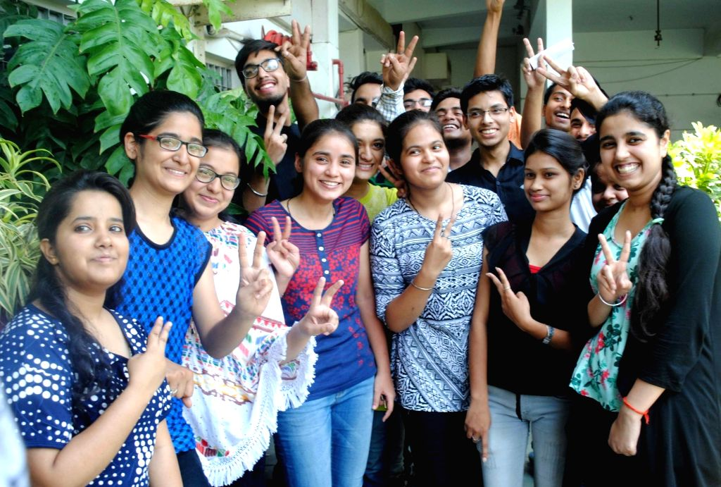 Students celebrate after Class 12 CBSE exams results were declared, in Allahabad on May 28, 2017.