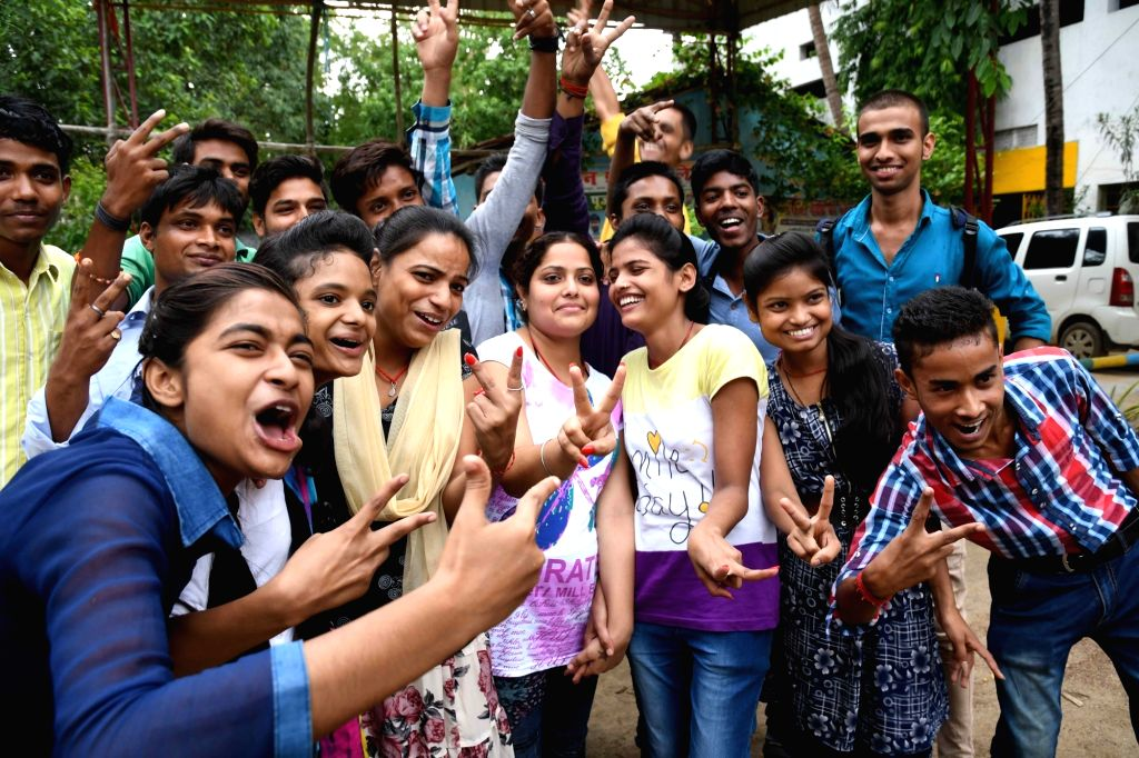Students celebrate after declaration of Bihar School Education Board (BSEB) class XII results in Patna on May 30, 2017.