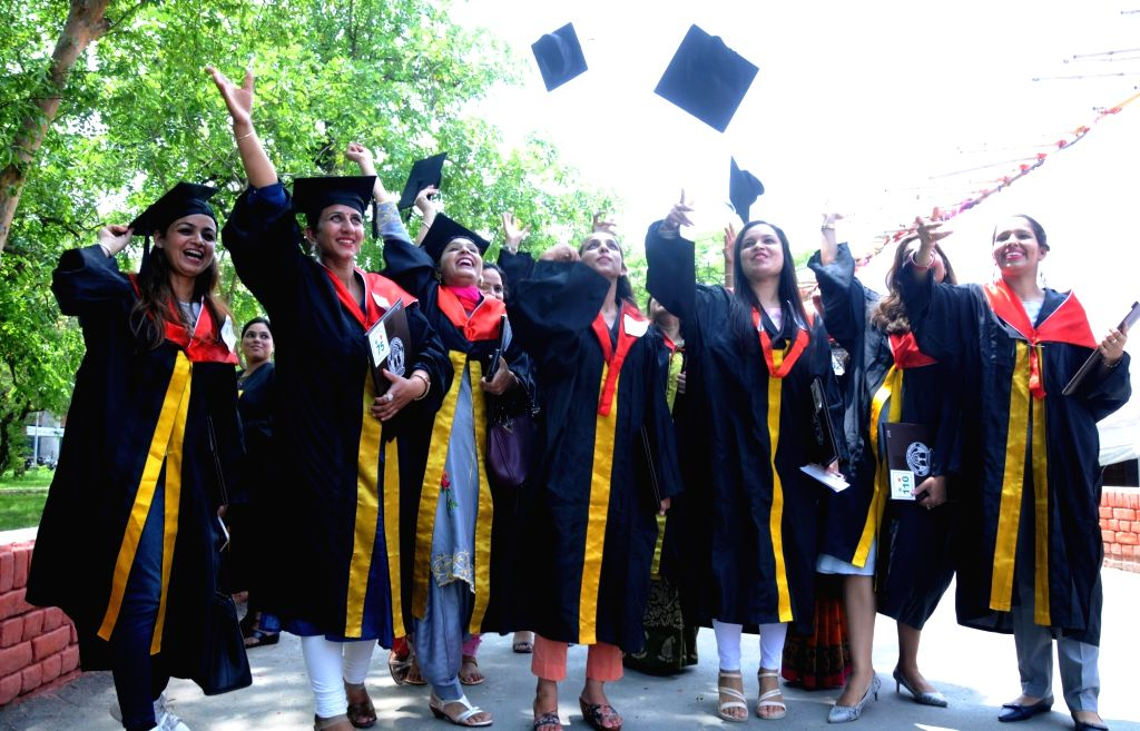 Students celebrate after receiving their degrees at the 50th convocation ceremony of Guru Nanak Dev University, in Amritsar on July 19, 2019. - Nanak Dev University
