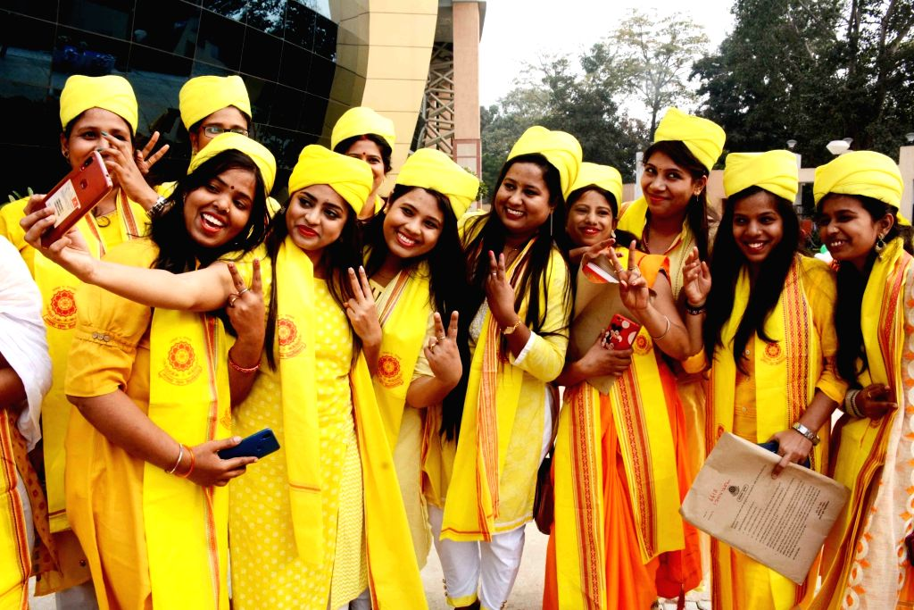 Students celebrate after receiving their degrees during the Convocation ceremony of Nalanda Open University, in Patna on Dec 11, 2019.
