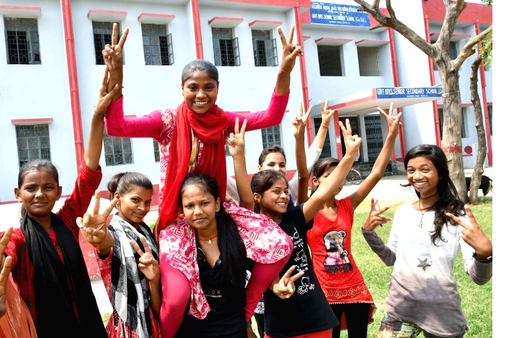 Students celebrate after the Bihar School Examination Board (BSEB) declared the results of Class 12 board examinations, in Patna on June 6, 2018.