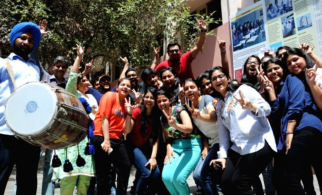 Students celebrate after the Central Board of Secondary Education (CBSE) declared results of the class 12 examinations, in Amritsar on May 26, 2018.