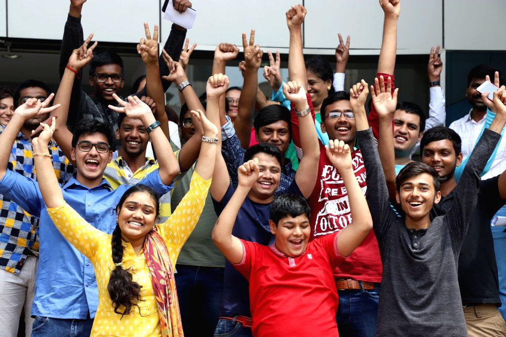 Students celebrate after the Central Board of Secondary Education (CBSE) declared results of the class 12 examinations, in Bengaluru on May 26, 2018.