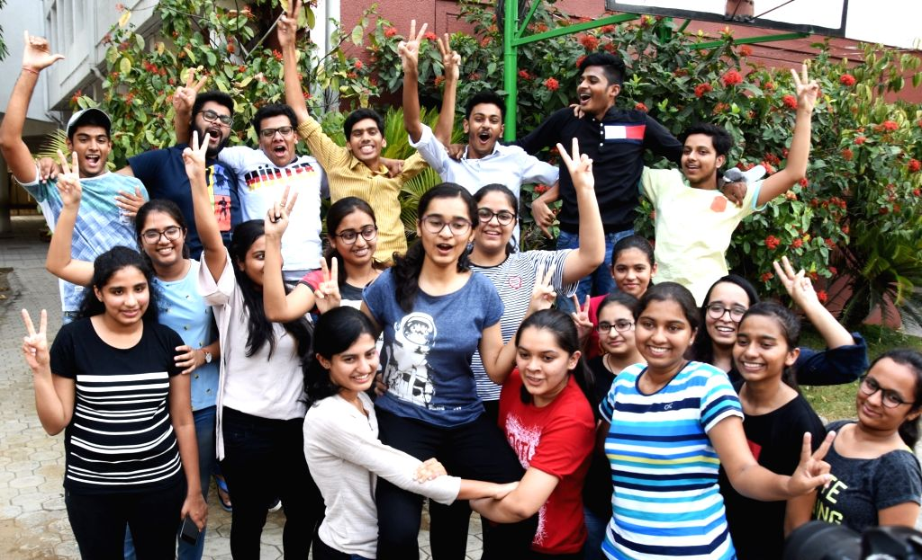 Students celebrate after the Central Board of Secondary Education (CBSE) declared results of the class 12 examinations, in Nagpur on May 26, 2018.