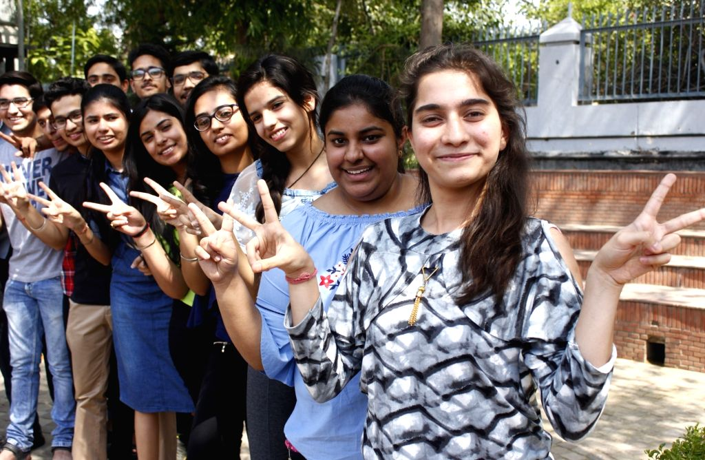 Students celebrate after the Central Board of Secondary Education (CBSE) declared results of the class 12 examinations, in Gurugram on May 26, 2018.