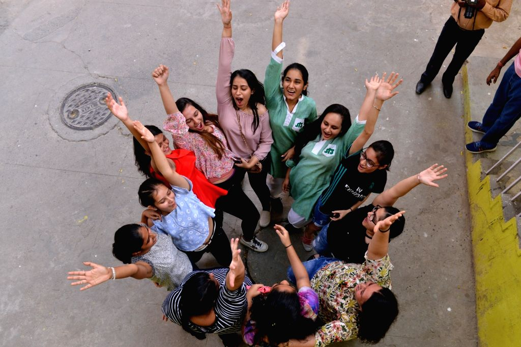 Students celebrate after the Central Board of Secondary Education (CBSE) declared the results of Class 10 examinations, in New Delhi on May 29, 2018. Students from 17,567 schools from ...