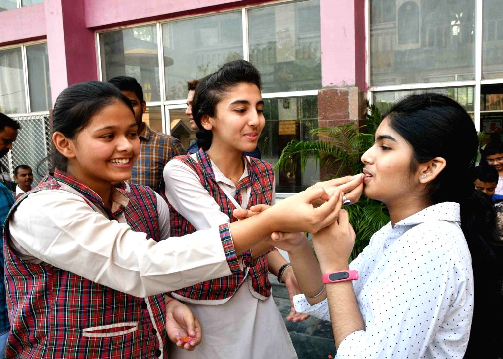 Students celebrate after the Central Board of Secondary Education (CBSE) declared the results of Class 10 examinations, in Patna on May 29, 2018. Students from 17,567 schools from across the ...