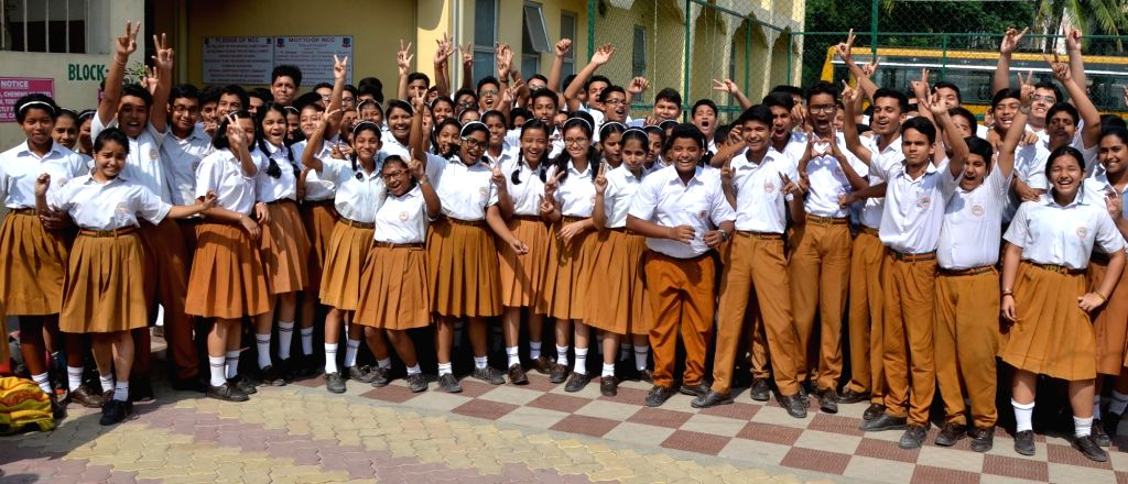 Students celebrate after the Central Board of Secondary Education (CBSE) declared the results of Class 10 examinations, in Guwahati on May 29, 2018. Students from 17,567 schools from across ...