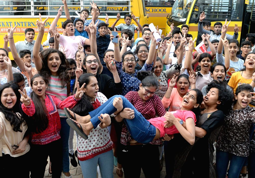 Students celebrate after the Central Board of Secondary Education (CBSE) declared the results of Class 10 examinations, in Bengaluru on May 29, 2018. Students from 17,567 schools from ...