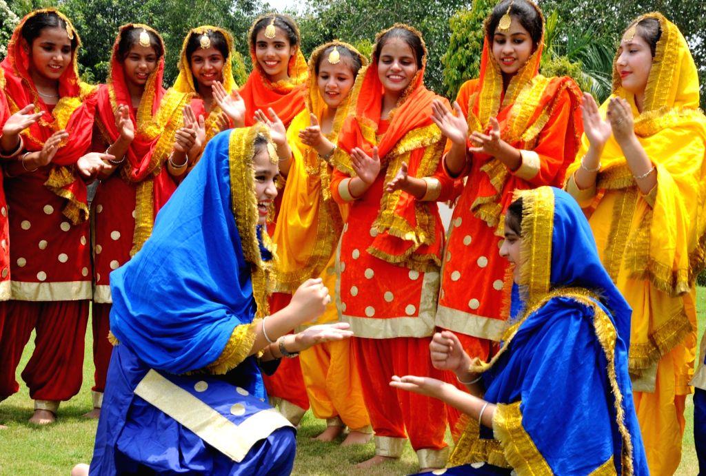 Students celebrate Teej Festival in Amritsar on July 18, 2019.