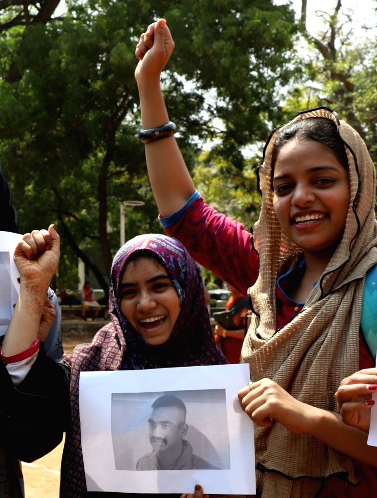 Students celebrate the safe return of Indian Air Force (IAF) pilot Abhinandan Varthaman in Bengaluru, on March 1, 2019. The 35-year-old Wing Commander was captured on Wednesday by Pakistan ...