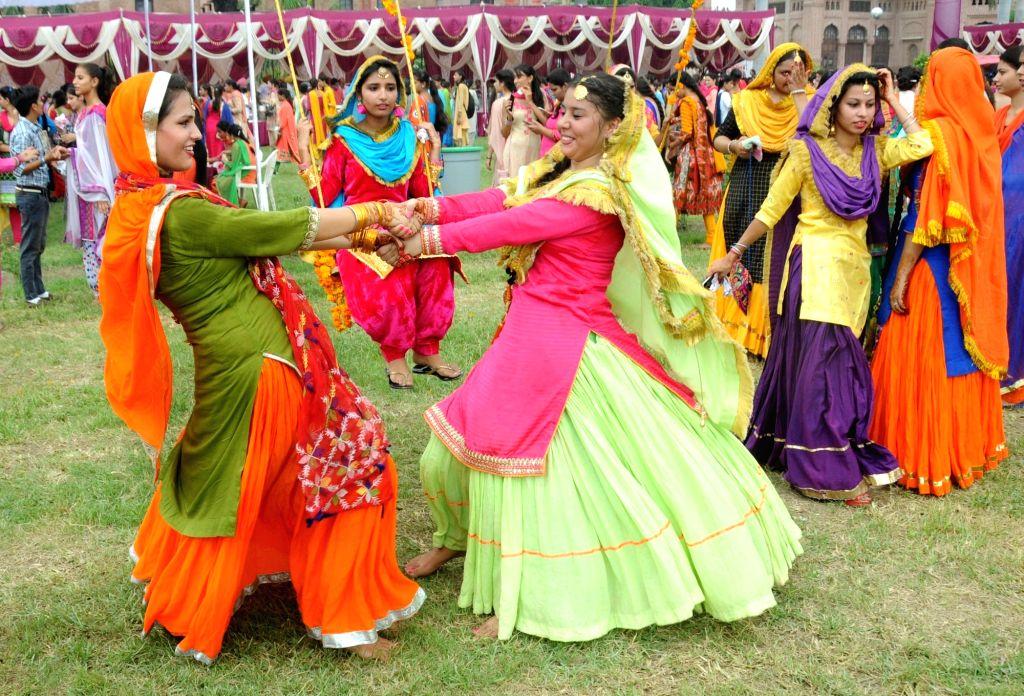 Students celebrate the Teej festival in Amritsar on Aug 13, 2016.