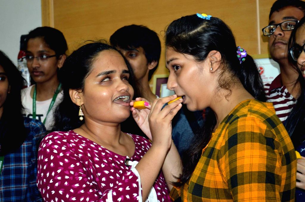 Students celebrate their performance after Maharashtra State Board of Secondary and Higher Secondary Education (MSBSHSE) declared the Class 12th results, in Mumbai on May 28, 2019.