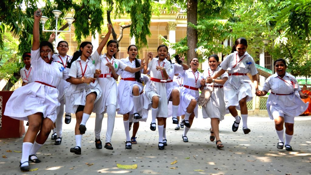 Students celebrate their performance after the West Bengal Board of Secondary Education (WBBSE) declared class 10 results in Kolkata, on May 21, 2019.