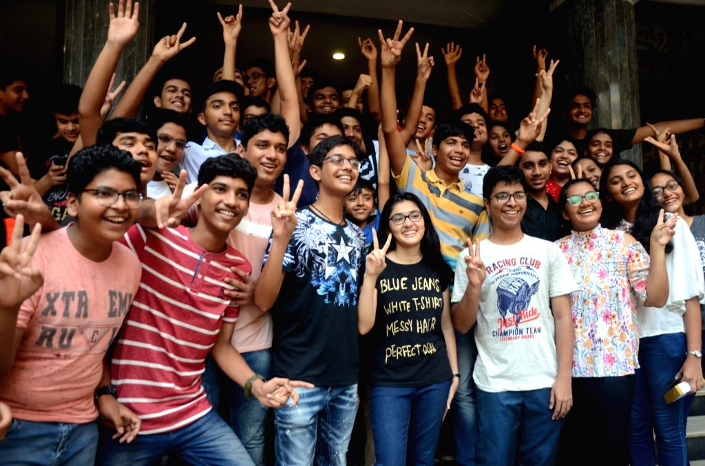 Students celebrate their performance after the Maharashtra State Board of Secondary and Higher Secondary Education (MSBSHSE) declared the results for class 10 Board examinations, in Mumbai on ...