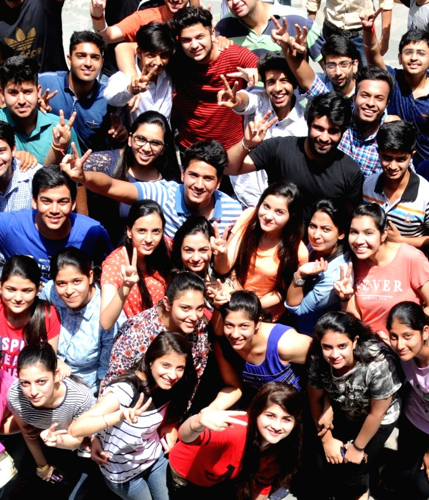 Students celebrate their success as CBSE announced Class 12 results in Amritsar on May 21, 2016.