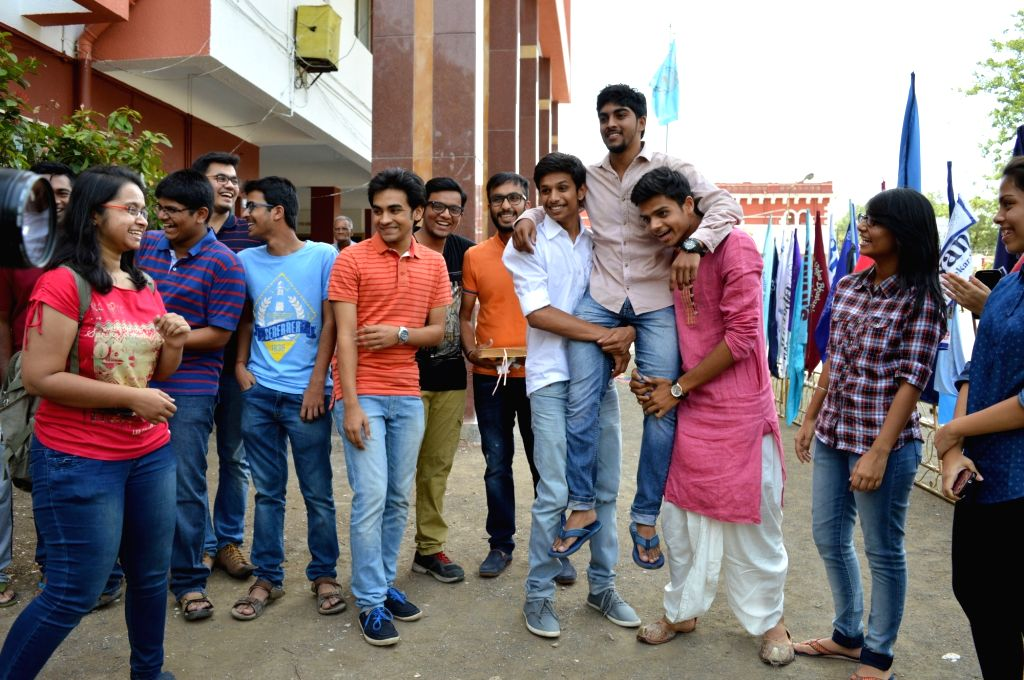Students celebrate their success as CBSE announced Class 12 results in Nagpur on May 21, 2016.