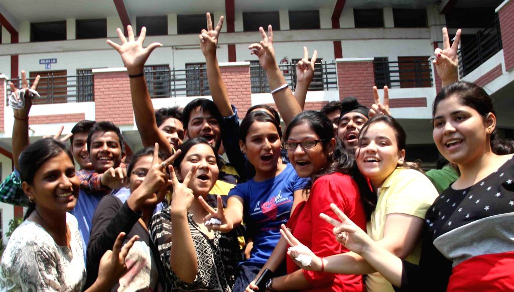 Students celebrate their success as CBSE announced Class 12 results in Allahabad on May 21, 2016.