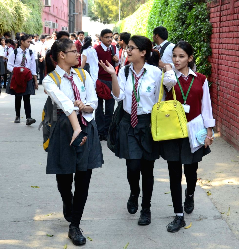 Students comes out of an examination centre after writing their Class-X and XII examination of Central Board of Secondary Education in New Delhi on March 9, 2017.