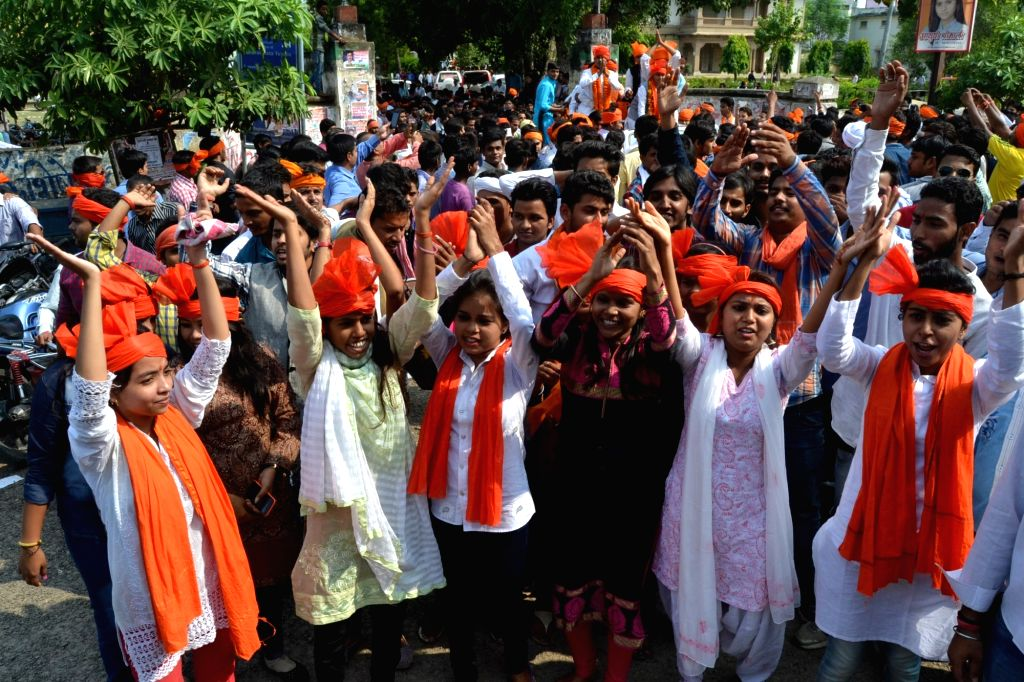 Students dance as their representative files nomination for Students' Union elections at Mahatma Gandhi Kashi Vidyapith in Varanasi, on Oct 30, 2015.