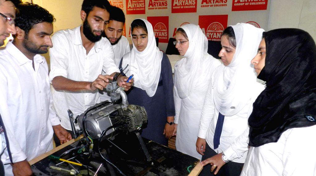 Students demonstrate their models at `ROBOTRYST 2014-15`  in Chandigarh on Sept 4, 2014.