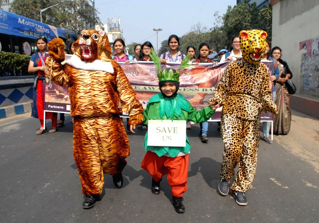 Students dressed up as different animals participate in wildlife awareness rally in Kolkata on Feb 9, 2020.
