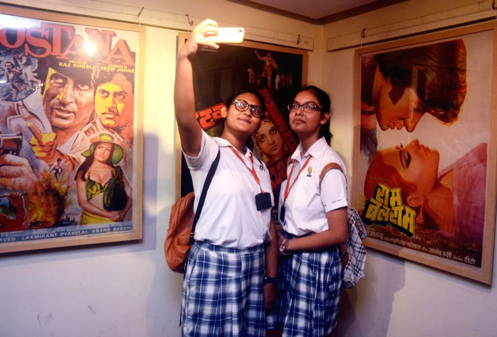 Students during an exhibition organsied on Amitabh Bachchan's 75th birthday in Kolkata, on Oct 11, 2017. - Amitabh Bachchan
