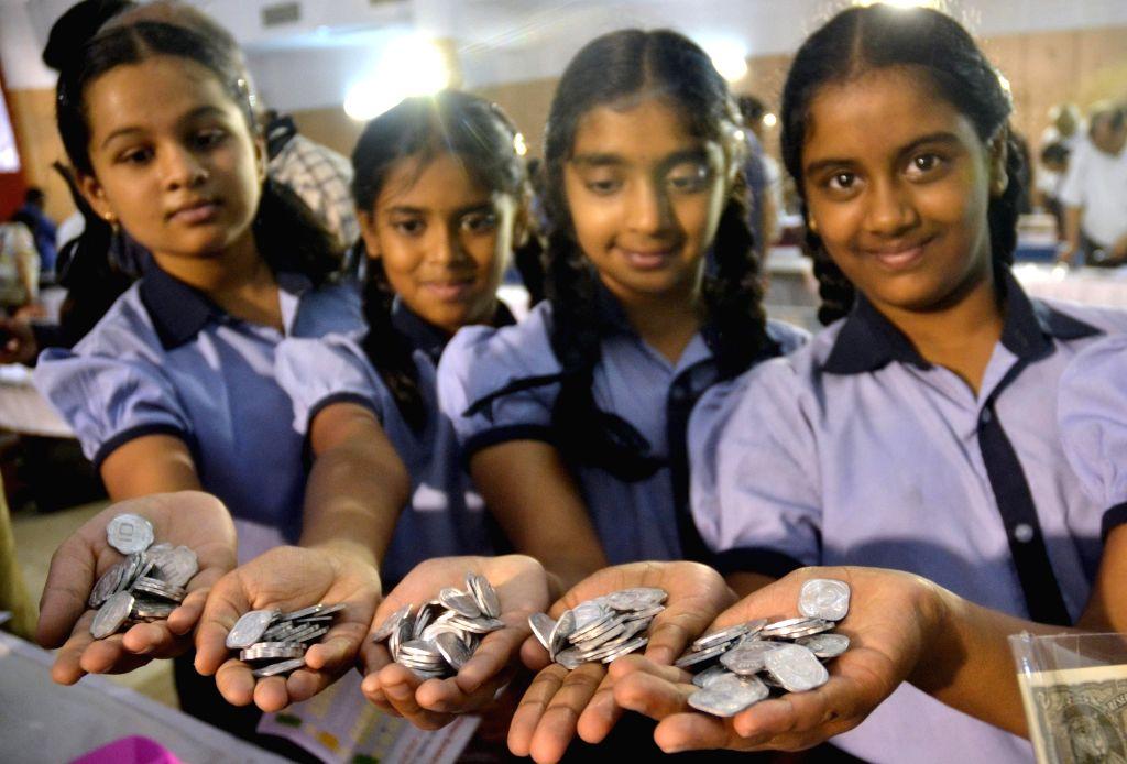 "Students during ""Nanyadarshini - 2016 - a rare coins and currencies exhibition"" organised by Alia Karnataka Numismatic Society, in Bengaluru on July 15, 2016."