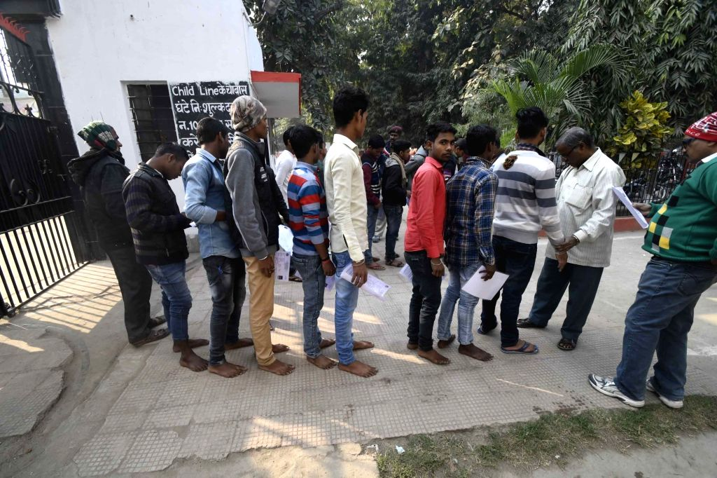 Students enter an exam centre bare foot to appear for higher secondary exams conducted by Bihar School Examination Board (BSEB) as they are barred from wearing shoes, in Patna on Feb 6, 2019.