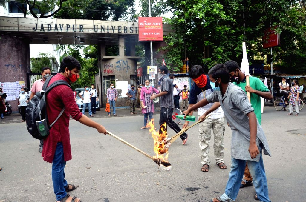 Students Federation of India (SFI) activists protest against the three contentious agriculture-related Bills that have led to agitation by farmers in many states; in front of Jadavpur ...