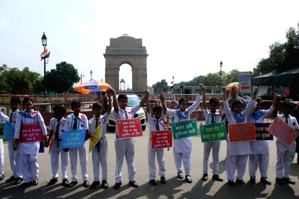 Students form a human chain during 'Save Water, Save Environment' rally organised as part of an awareness drive on climate change, at India Gate in New Delhi on Sep 21, 2019.