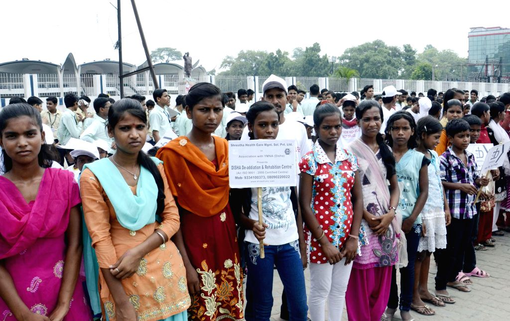 Students form human chain to observe United Nations' International Day Against Drug Abuse and Illicit Trafficking in Patna on June 26, 2014.