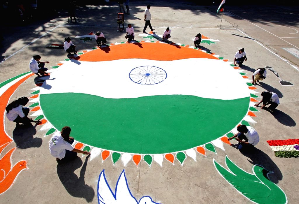 Students from Bhandava Trust make a 3000 square feet tricolor rangoli on the eve of Republic Day celebrations 2020, at Jayanagar Grounds in Bengaluru on Jan 25, 2020.