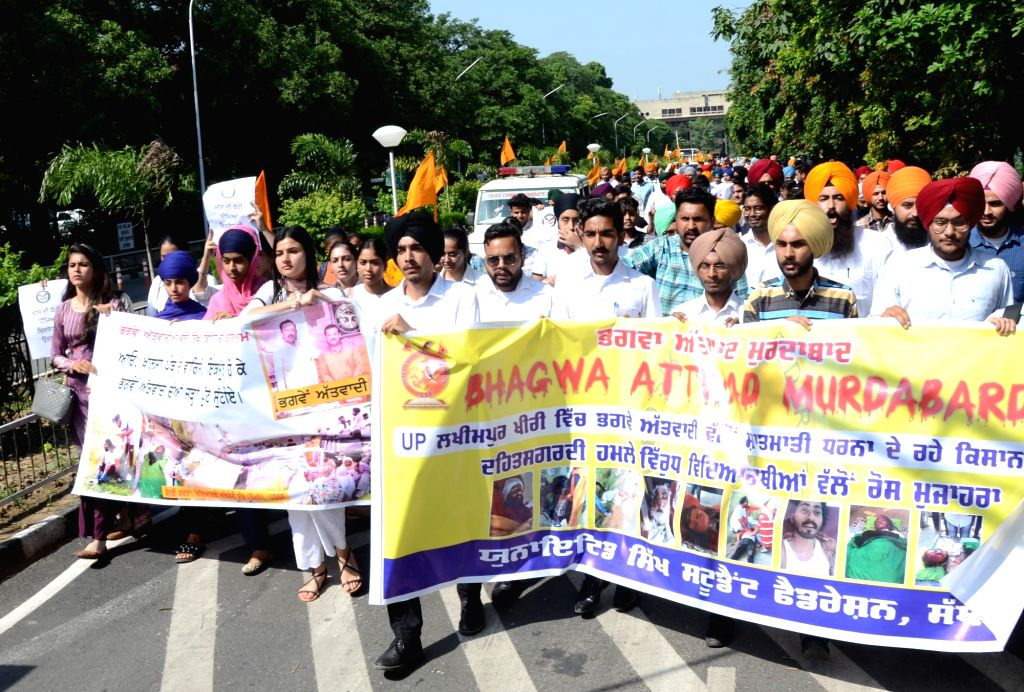 Students from Guru Nanak Dev University as they  raise slogans during a protest against the Lakhimpur Kheri incident,in Amritsar on Monday october 04,2021. - Nanak Dev University
